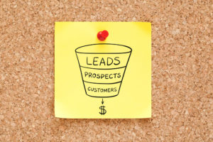 yellow post it with hand-drawn sales funnel
